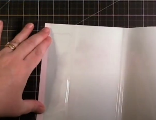 Attach clear sheet to top of the page